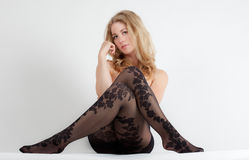 Woman in Floral Pattern Tights Stock Image