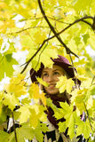 Woman in a floral patterned coat and wine red hat in the park, by the river. Happy girl, colorful autumn forest. Portrait of lady Stock Photography