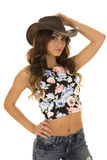 Woman in floral shirt cowgirl hand on hat Royalty Free Stock Images