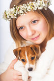 Woman in floral wreath with Jack Russell Terrier puppy Stock Photography