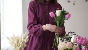 Woman florist gathering bouquet in flower shop stock footage