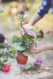 Woman florist making bouquet  outdoors Stock Image