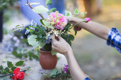 Woman florist making bouquet outdoors Stock Photo