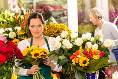 Woman florist selling sunflowers bouquet flower shop. Market buying Royalty Free Stock Image