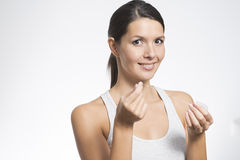 Woman flossing her teeth Stock Images