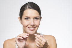Woman flossing her teeth Royalty Free Stock Photos