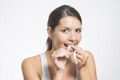 Woman flossing her teeth Stock Photo
