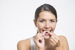 Woman flossing her teeth Stock Photos