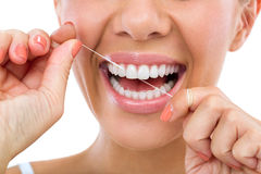 Woman flossing her teeth Royalty Free Stock Image