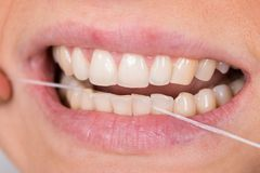 Woman flossing teeth Stock Photos