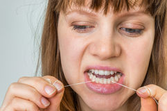 Woman flossing teeth with dental floss Royalty Free Stock Photos