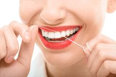 Woman flossing teeth Royalty Free Stock Photo