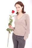 Woman with a flower. The young beautiful woman with a rose stock images