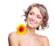 Woman with a flower. Beautiful young blond curly woman with a flower on the shoulder Stock Images