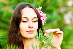 Woman with flower. Portrait of a beautiful woman with a flower in the head Royalty Free Stock Photo