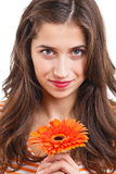 Woman with flower. Beautiful young woman with a flower in her hands Royalty Free Stock Images
