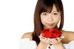 Woman And Flower. An attractive young Asian woman in white top holding a red flower on white background Royalty Free Stock Photo