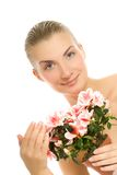Woman with a flower Stock Image