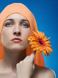 Woman with flower. Woman with flower сlose-up of beautiful face Stock Photography