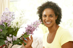 Woman Flower Arranging At Home stock image