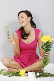 Woman flower arranging Stock Photos
