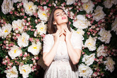 Woman on flower background posing sexy Stock Images