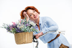 Woman with flower basket Stock Images
