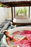 Woman In Flower Bath At Day Spa Salon Stock Photos