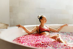 Woman In Flower Bath At Day Spa Salon Stock Photography