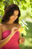 Woman with flower. Royalty Free Stock Photos