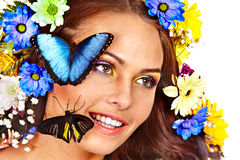 Woman with flower and  butterfly. Royalty Free Stock Photography