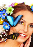 Woman with flower and  butterfly. Royalty Free Stock Photos