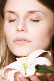 Woman with flower close up Stock Images