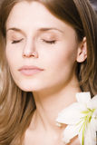 Woman with flower close up Royalty Free Stock Image