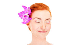 Woman with flower and closed eye's Royalty Free Stock Photos