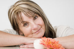 Woman with flower and cream Royalty Free Stock Photo