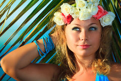 Woman in flower diadem Royalty Free Stock Image