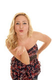 Woman flower dress blow kiss one hand Royalty Free Stock Photo