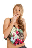 Woman flower dress finger in mouth Stock Photography