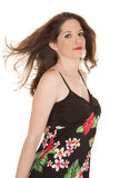 Woman flower dress hair blow serious. A woman in a flower dress standing with her hair blowing Royalty Free Stock Image