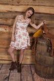 Woman flower dress hold onto saddle Stock Photography