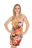 Woman in flower dress smile hands hips Royalty Free Stock Photography