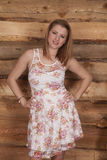 Woman flower dress wood background smile Stock Photography
