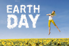 Woman with flower and Earth Day text Royalty Free Stock Photography