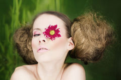 Woman with flower on eye Stock Photo