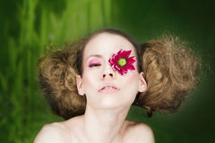 Woman with flower on eye Royalty Free Stock Images