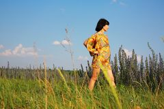 Woman on the flower field Stock Photography