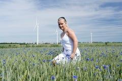 Woman in flower field Stock Photo