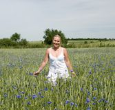 Woman in flower field Royalty Free Stock Images