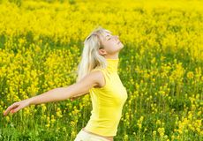 Woman in a flower field Royalty Free Stock Photo